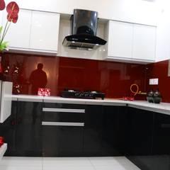 Kitchen Cabinet with Storage Shutters:  Kitchen by Enrich Interiors & Decors