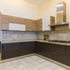 three tone kitchen: modern Kitchen by NVT Quality Build solution