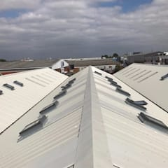 ARTISTIC SPACES Artistic Spaces needed their asbestos roof safely removing and replacing to open up their space to let in as much natural light as possible. Find out more about this project here. :  Commercial Spaces by JDB Refurbishments Limited