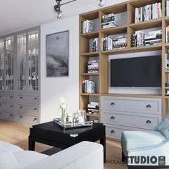 salon ze ścianką TV: styl , w kategorii Salon zaprojektowany przez MIKOŁAJSKAstudio