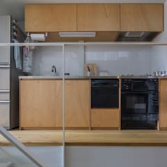 『』の家: 山本嘉寛建築設計事務所 YYAAが手掛けたキッチンです。