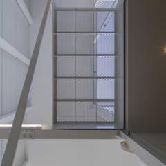 『』の家: 山本嘉寛建築設計事務所 YYAAが手掛けた階段です。,インダストリアル 鉄/鋼