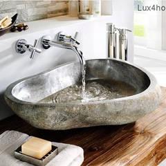 Umywalka z kamienia naturalnego polnego w łazience: styl , w kategorii Łazienka zaprojektowany przez Lux4home™
