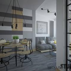 ściana z geometrycznymi wzorami: styl , w kategorii Jadalnia zaprojektowany przez MIKOŁAJSKAstudio