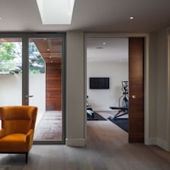 Basement gym and wine cellar:  Gym by Thomas & Spiers Architects