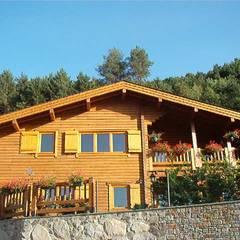 RUSTICASA | 10 projets | Andorre: Chalets & maisons en bois de style  par EC-BOIS
