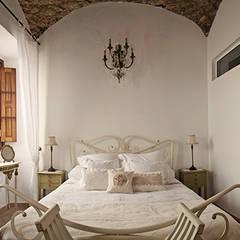The Marmalade House:  Bedroom by Sena Architects