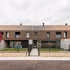 EC-Bois | Multi Home Experience | Les Alluets-le-Roi: Habitats collectifs de style  par EC-BOIS