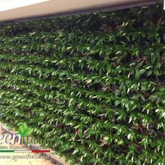 GIARDINO VERTICALE INGRESSO CALL CENTER: Centri commerciali in stile  di Green Habitat s.r.l.