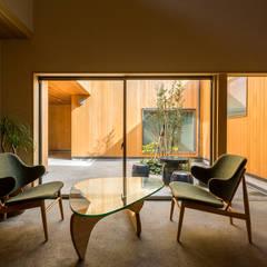 おおらかな方流れ屋根の家: アトリエ慶野正司 ATELIER KEINO SHOJI ARCHITECTSが手掛けた廊下 & 玄関です。,オリジナル