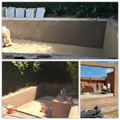 Construcción de pileta : Piletas de jardín de estilo  por M2 Arquitectura