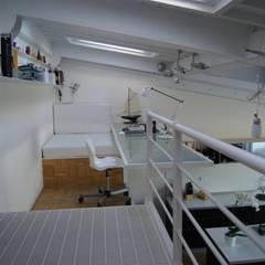 Realizzazione attico Massa: Studio in stile  di Della Bona & Fiorentini Studio di Architettura