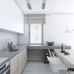 nowoczesna kuchnia: styl , w kategorii Kuchnia na wymiar zaprojektowany przez MIKOŁAJSKAstudio