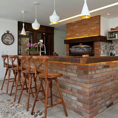 Dining room by Maciel e Maira Arquitetos