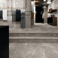 Porcelanato Quintessenza / Gante: Oficinas y tiendas de estilo  por Skyfloor