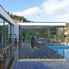 Piscinas infinitas de estilo  por AD+ arquitectura