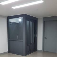 등촌동 현대 아이파크 아파트: DECORIAN의  복도 & 현관