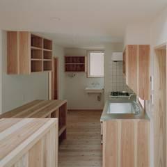 木づくりの家: 前田工務店が手掛けたキッチンです。