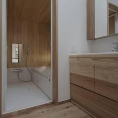 木づくりの家: 前田工務店が手掛けた浴室です。