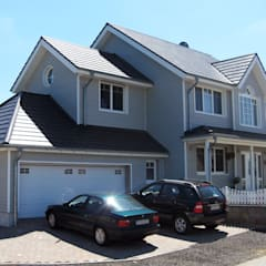Neubau eine Einfamilienhauses im Amerikanischen Stil:  Häuser von STRICK  Architekten + Ingenieure