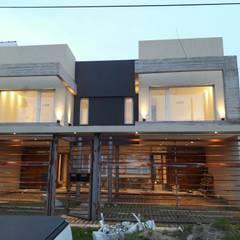 Buitenhuis door Comodo-Estudio+Diseño