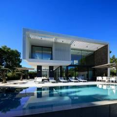 Moradia Quinta do Lago   : Piscinas modernas por JMM Group