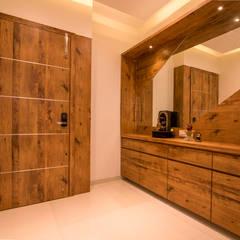 Mr Vinay: rustic Living room by GREEN HAT STUDIO PVT LTD