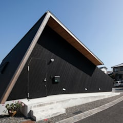 Casas de madera de estilo  por 伊藤憲吾建築設計事務所