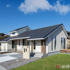 Wooden houses by 納得住宅工房株式会社 Nattoku Jutaku Kobo.,Co.Ltd., Modern