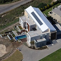 Residence, Little Walmer Golf Estate:  Roof by The Matrix Urban Designers and Architects,