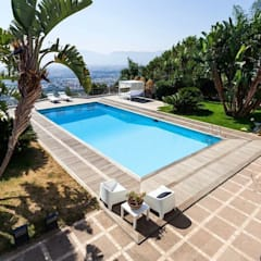 Villa a Palermo: Giardino con piscina in stile  di FDR architetti -francesco e danilo reale