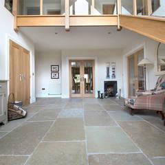 A Beautiful Entrance: Umbrian Limestone:  Corridor & hallway by Quorn Stone