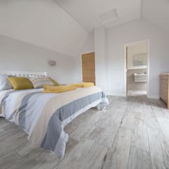 Coastal Rebuild: Pebbleshore Wood Effect Porcelain:  Bedroom by Quorn Stone