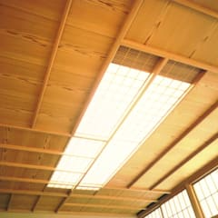客間天井: 株式会社 ギルド・デザイン一級建築士事務所が手掛けたバー & クラブです。