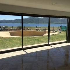 Casa NC: Jardines de estilo minimalista por Development Architectural group