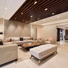 4BHK APARTMENT AT BKC:  Living room by Ar. Milind Pai