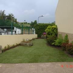 Moradia Silva Escura: Jardins  por Viveiros da Boa Nova, Lda