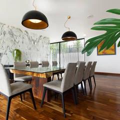 Casa Nochebuena: Comedores de estilo minimalista por Dionne Arquitectos
