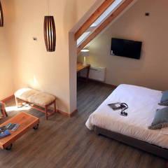 HOTEL SOLARIA PUCON: Hoteles de estilo  por INTEGRAR DISEÑO