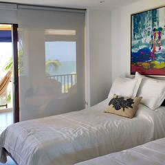 Dormitorios de estilo topical por Remodelar Proyectos Integrales