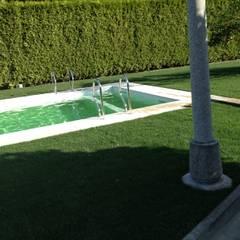 Garden Pool by JP Revestimentos, Isolamentos e Piscinas