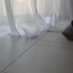 اتاق خواب توسطMatafora Tessili e Dintorni, مدرن