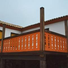 منزل ريفي تنفيذ Hérmanes Abreu Arquitetura Ltda