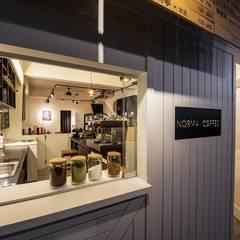 諾馬連鎖咖啡店 哈密店:  房子 by 捷士空間設計(省錢裝潢)