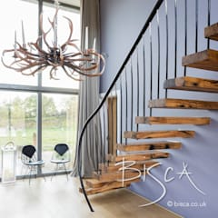 Flamed oak cantilevered staircase :  Stairs by Bisca Staircases