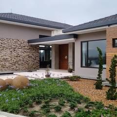 Casas de campo de estilo  por Espacios Positivos