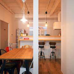 中野の家リノベーション: 大塚高史建築設計事務所が手掛けたダイニングです。