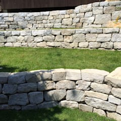 石積みの庭: 庭や煌久が手掛けたロックガーデンです。,モダン 石