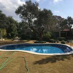 Sıdar Pool&Dome Yüzme Havuzları ve Şişme Kapamalar – Havuzun çevre düzenlemesi sonrası durumu:  tarz Bahçe havuzu