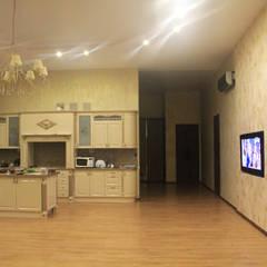 Одноэтажный дом для семьи: Гостиная в . Автор – Студия дизайна Elinarti